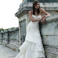Elegante witte bruidsjurk met stroken